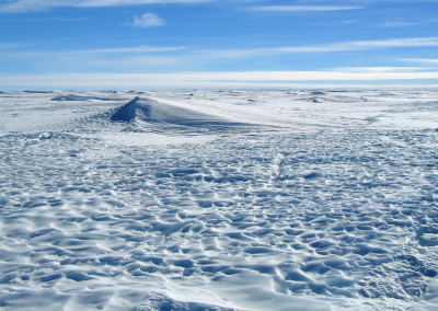Sculpted sastrugi surface on the ice cap.
