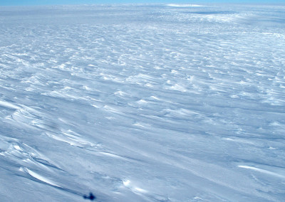 The polar plateau with aircraft shadow.