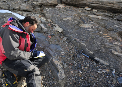 John working in the field at an outcrop.