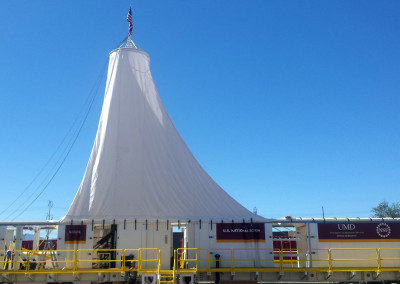 Canopy erected over the joined drill and rod skids.