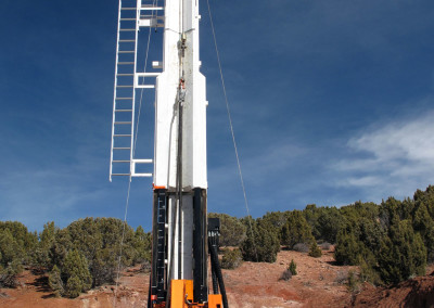 Operating the Boart Longyear LF230 drill rig at the test site.