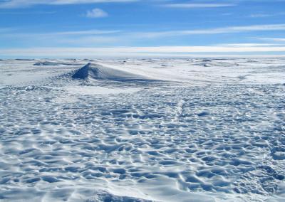 Sculpted sastrugi surface on the ice cap.
