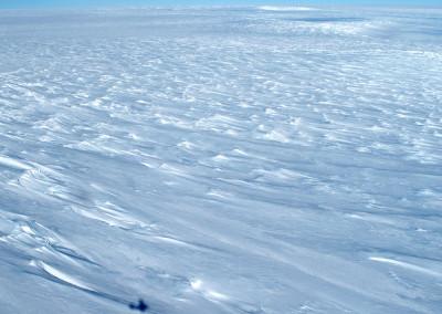 The polar plateau with aircraft shadow.